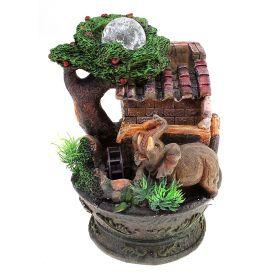 Фонтан Слоны с монетками под деревом